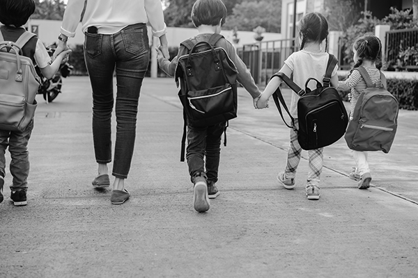 Children walking to school with adult