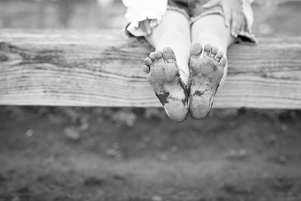 Child with muddy feet